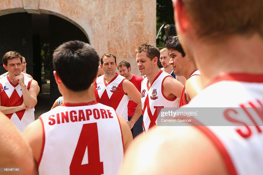 Grant Bell of the Wombats talks to team mates during a Singapore Wombats Aussie Rules training session at Fort Canning Park on February 23, 2013 in Singapore. The Singapore Australian Football Club (SAFC), known as the Singapore Wombats is celebrating 20 years this year. Established by Australian expatriates in 1993, the amateur team plays clubs from Indonesia, Japan, the Philippines, Thailand and Vietnam in an Asian Championship.