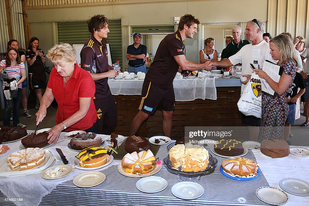 <a gi-track='captionPersonalityLinkClicked' href=/galleries/search?phrase=Grant+Birchall&family=editorial&specificpeople=762728 ng-click='$event.stopPropagation()'>Grant Birchall</a> choses the winner of the cake baking competition at the Bream Creek Oval during the Hawthorn Hawks AFL Tasmania Community Camp on February 23, 2014 in Bream Creek, Australia.