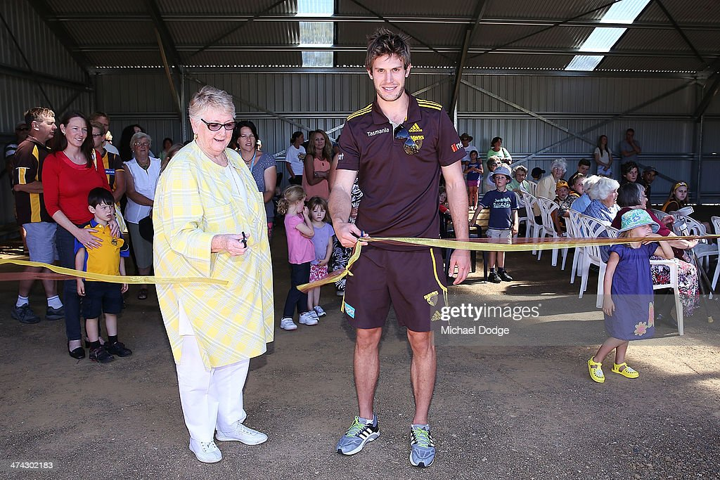 Grant Birchall cuts the ribbon to celebrate the opening of the new pavillion at the Bream Creek Oval during the Hawthorn Hawks AFL Tasmania Community Camp on February 23, 2014 in Bream Creek, Australia.