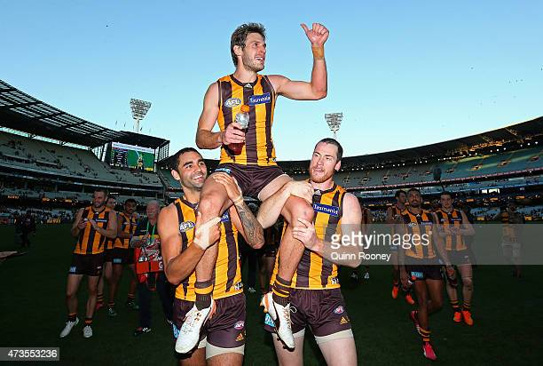 Grant Birchall of the Hawks is chaired off the ground by Shaun Burgoyne and Jarryd Roughead after playing his 200th game during the round seven AFL...