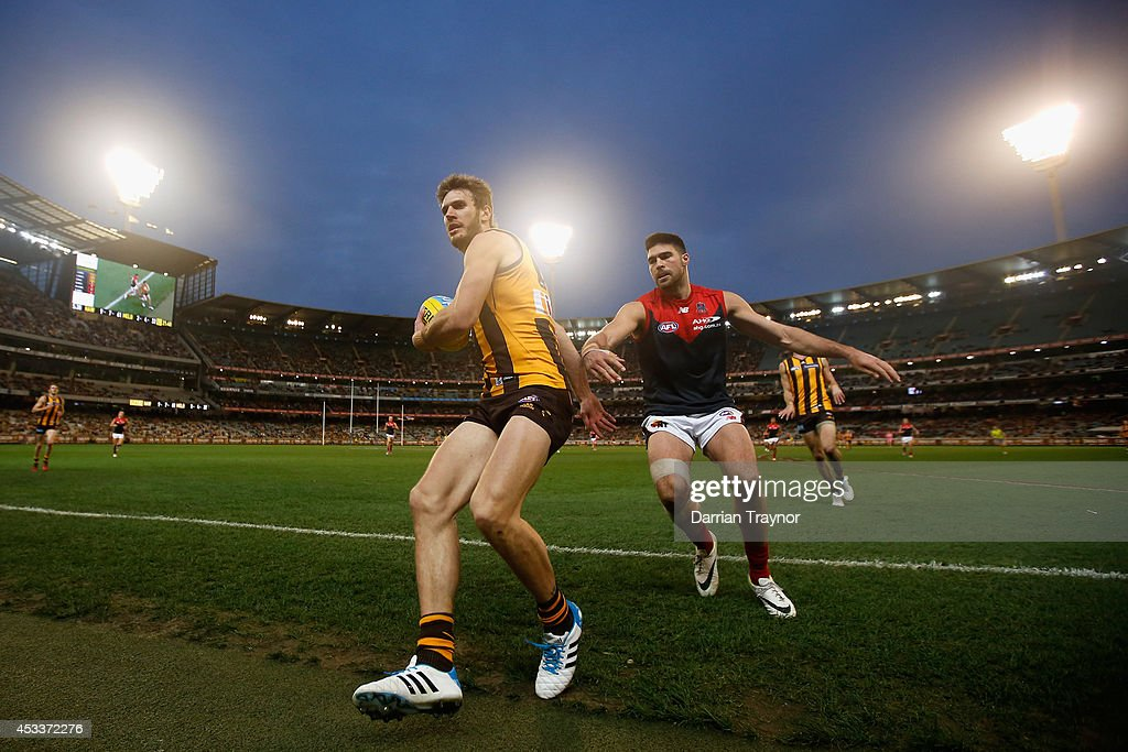 <a gi-track='captionPersonalityLinkClicked' href=/galleries/search?phrase=Grant+Birchall&family=editorial&specificpeople=762728 ng-click='$event.stopPropagation()'>Grant Birchall</a> of the Hawks is pushed out of bounds by Chris Dawes of the Demons during the round 20 AFL match between the Hawthorn Hawks and the Melbourne Demons at Melbourne Cricket Ground on August 9, 2014 in Melbourne, Australia.
