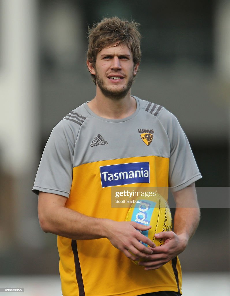 Grant Birchall of the Hawks passes the ball during a Hawthorn Hawks AFL training session at Waverley Park on May 13, 2013 in Melbourne, Australia.