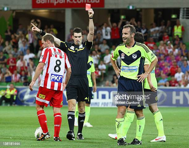Grant Brebner of the Victory is shown the red card by referee Jarred Gillett during the round 18 ALeague match between the Melbourne Heart and the...