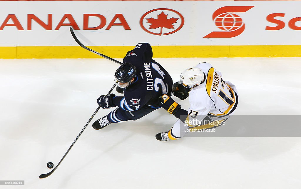 <a gi-track='captionPersonalityLinkClicked' href=/galleries/search?phrase=Grant+Clitsome&family=editorial&specificpeople=4596638 ng-click='$event.stopPropagation()'>Grant Clitsome</a> #24 of the Winnipeg Jets carries the puck around the net as <a gi-track='captionPersonalityLinkClicked' href=/galleries/search?phrase=Nick+Spaling&family=editorial&specificpeople=4112920 ng-click='$event.stopPropagation()'>Nick Spaling</a> #13 of the Nashville Predators gives chase during second period action at the MTS Centre on October 20, 2013 in Winnipeg, Manitoba, Canada.