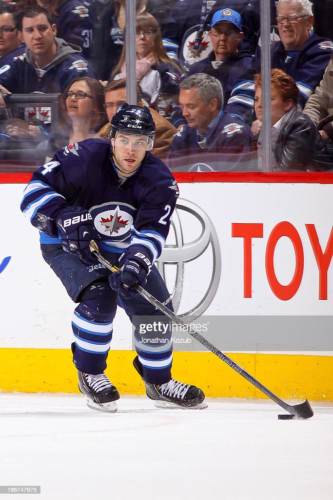 Grant Clitsome of the Winnipeg Jets carries the puck up the ice during third period action against the Buffalo Sabres at the MTS Centre on April 9...