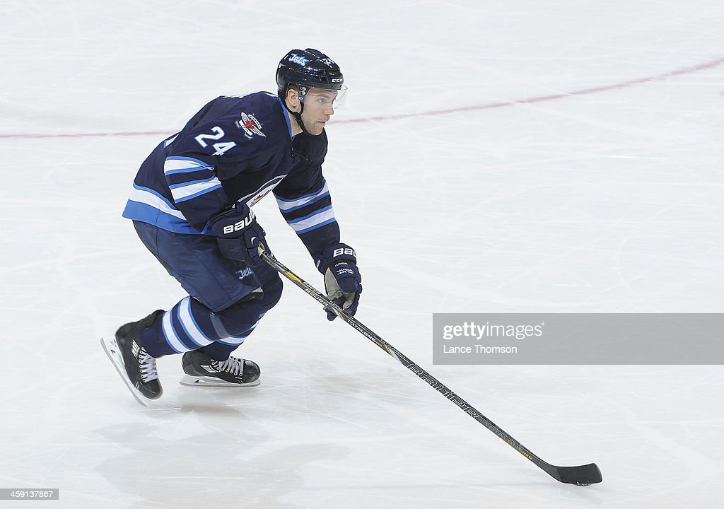Grant Clitsome of the Winnipeg Jets carries the puck up the ice during second period action against the Colorado Avalanche at the MTS Centre on...