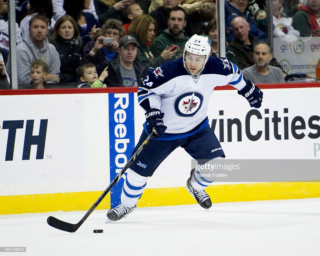 Grant Clitsome of the Winnipeg Jets controls the puck during the game against the Minnesota Wild on November 17 2013 at Xcel Energy Center in St Paul...