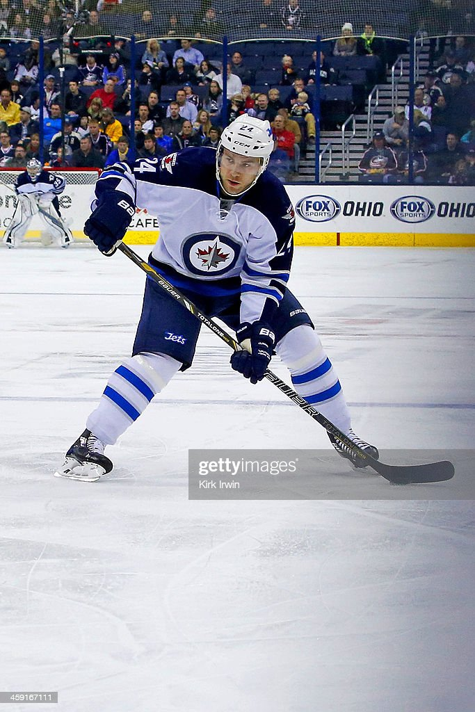 Grant Clitsome of the Winnipeg Jets controls the puck during the game against the Columbus Blue Jackets on December 16 2013 at Nationwide Arena in...