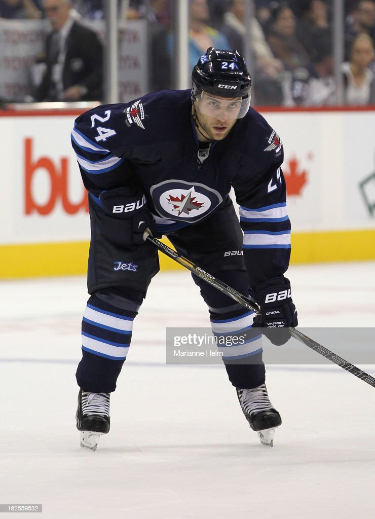 Grant Clitsome of the Winnipeg Jets gets ready for a faceoff during second period in an NHL preseason game against the Boston Bruins at the MTS...