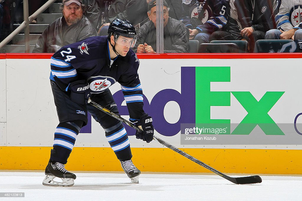 Grant Clitsome of the Winnipeg Jets gets set for a third period faceoff against the Philadelphia Flyers at the MTS Centre on November 15 2013 in...