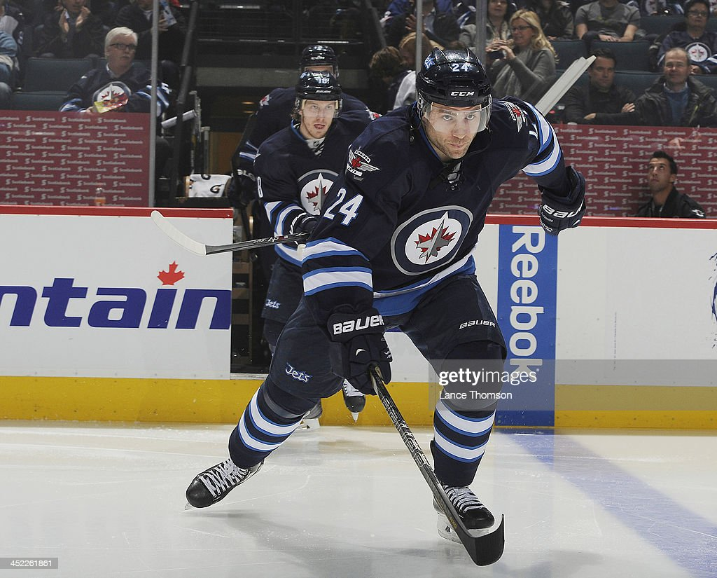 Grant Clitsome of the Winnipeg Jets hits the ice prior to puck drop against the Philadelphia Flyers at the MTS Centre on November 15 2013 in Winnipeg...