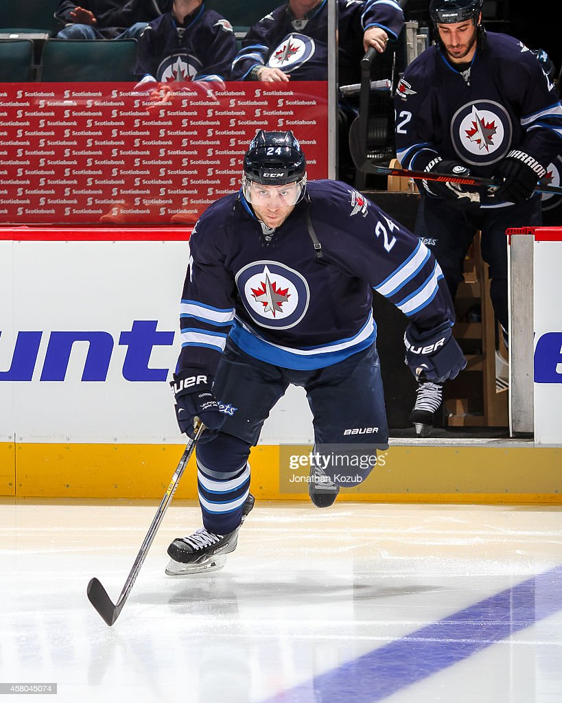 Grant Clitsome of the Winnipeg Jets hits the ice prior to puck drop against the Carolina Hurricanes on October 21 2014 at the MTS Centre in Winnipeg...