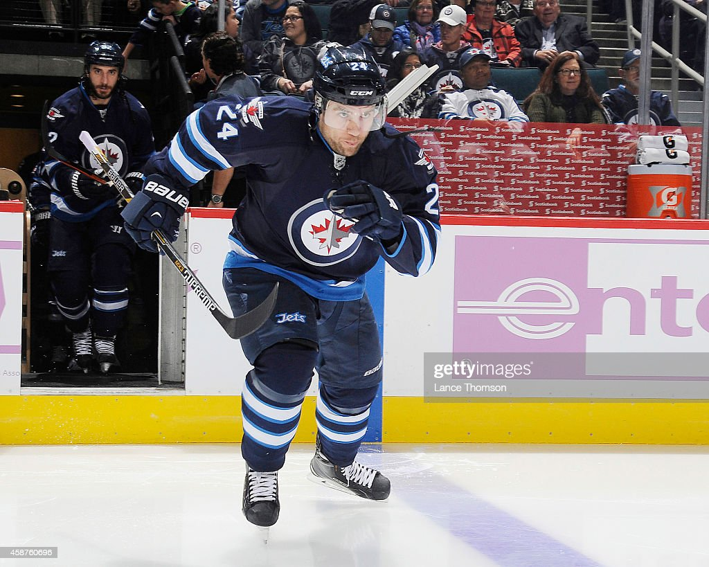 Grant Clitsome of the Winnipeg Jets hits the ice prior to puck drop against the Nashville Predators on November 4 2014 at the MTS Centre in Winnipeg...