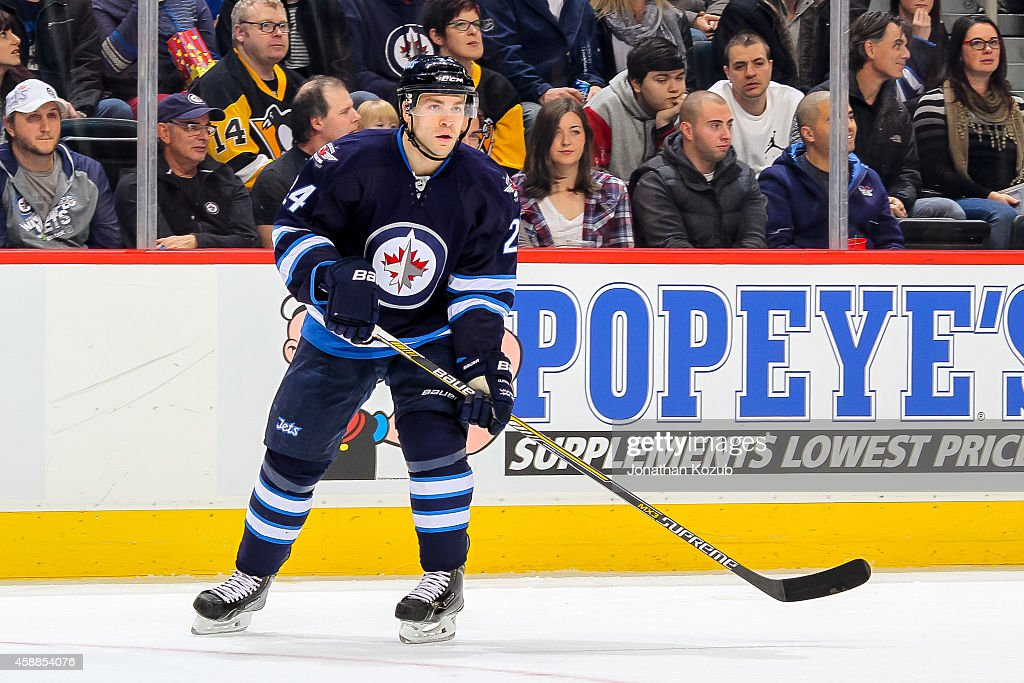 Grant Clitsome of the Winnipeg Jets keeps an eye on the play during first period action against the Pittsburgh Penguins on November 6 2014 at the MTS...