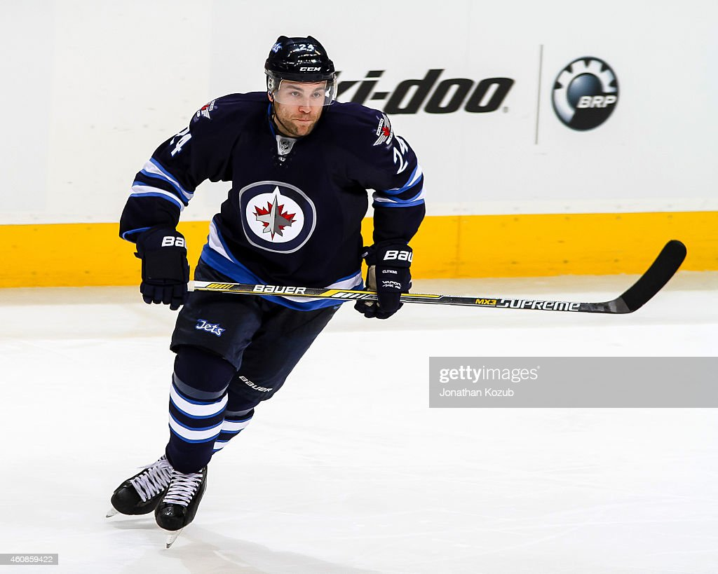 Grant Clitsome of the Winnipeg Jets keeps an eye on the play during third period action against the Boston Bruins on December 19 2014 at the MTS...