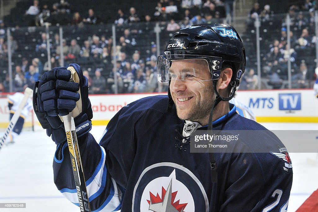 Grant Clitsome of the Winnipeg Jets looks on during the pregame warm up prior to NHL action against the St Louis Blues on November 23 2014 at the MTS...