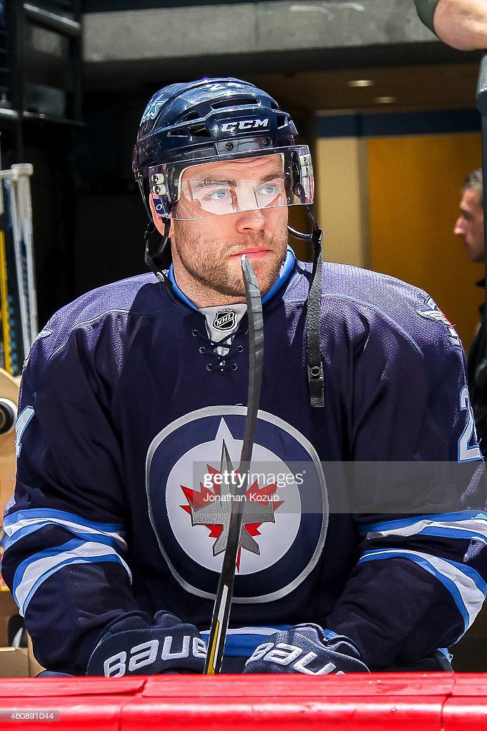 Grant Clitsome of the Winnipeg Jets looks on from the bench prior to puck drop against the Philadelphia Flyers on December 21 2014 at the MTS Centre...