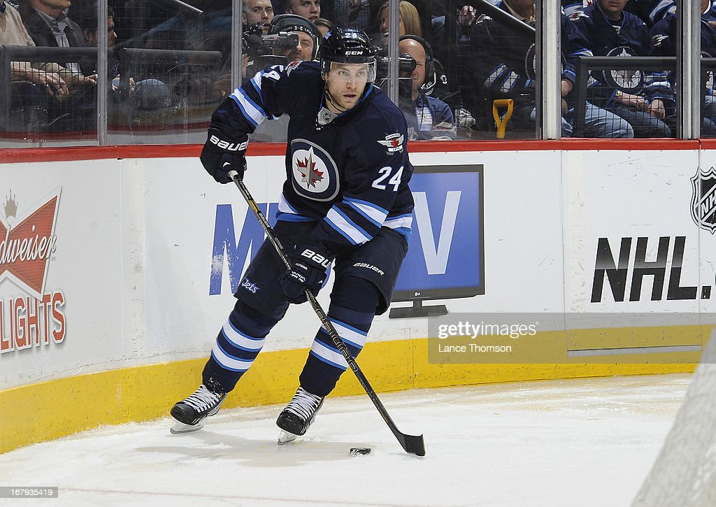 Grant Clitsome of the Winnipeg Jets plays the puck behind the net during third period action against the Montreal Canadiens at the MTS Centre on...