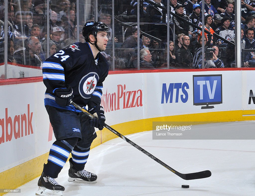 Grant Clitsome of the Winnipeg Jets plays the puck behind the net during third period action against the Philadelphia Flyers at the MTS Centre on...
