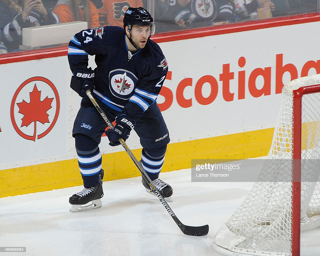 Grant Clitsome of the Winnipeg Jets plays the puck behind the net during second period action against the Philadelphia Flyers on December 21 2014 at...