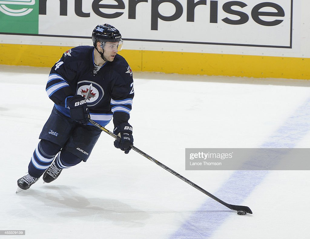 Grant Clitsome of the Winnipeg Jets plays the puck up the ice during second period action against the Chicago Blackhawks at the MTS Centre on...