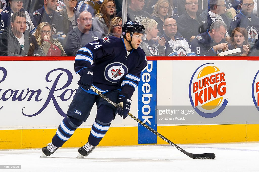 Grant Clitsome of the Winnipeg Jets plays the puck up the ice during first period action against the Tampa Bay Lightning on October 24 2014 at the...