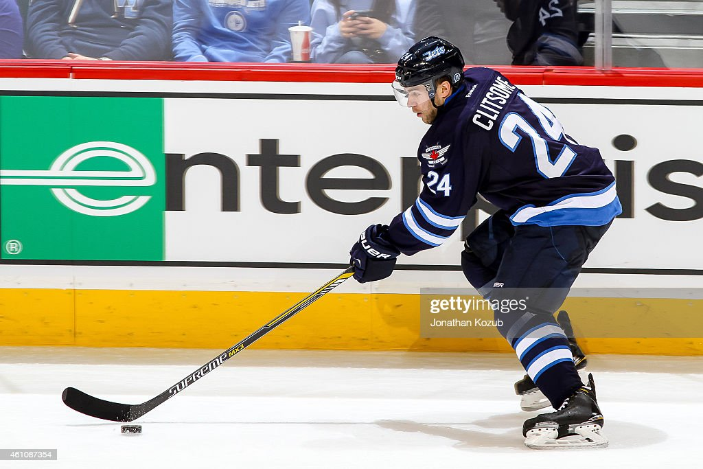 Grant Clitsome of the Winnipeg Jets plays the puck up the ice during second period action against the Minnesota Wild on December 29 2014 at the MTS...