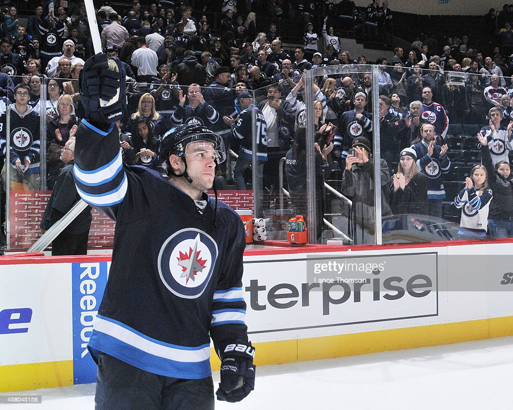 Grant Clitsome of the Winnipeg Jets salutes the crowd after receiving third star honors following a 31 victory over the Carolina Hurricanes on...