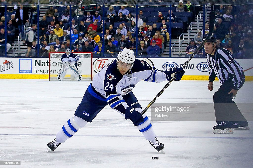 Grant Clitsome of the Winnipeg Jets shoots the puck during the game against the Columbus Blue Jackets on December 16 2013 at Nationwide Arena in...