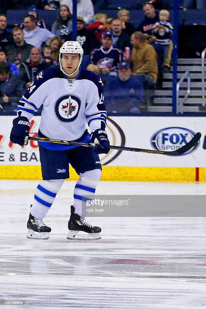 Grant Clitsome of the Winnipeg Jets skates after the puck during the game against the Columbus Blue Jackets on December 16 2013 at Nationwide Arena...