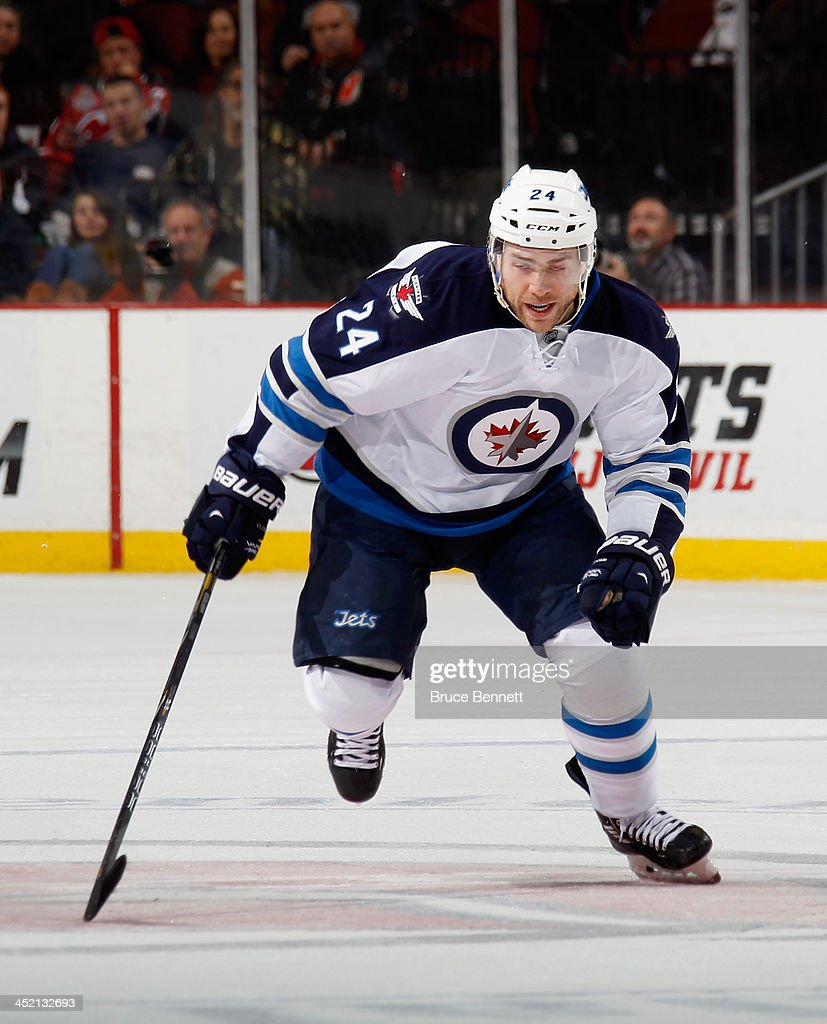 Grant Clitsome of the Winnipeg Jets skates against the New Jersey Devils at the Prudential Center on November 25 2013 in Newark New Jersey The Jets...