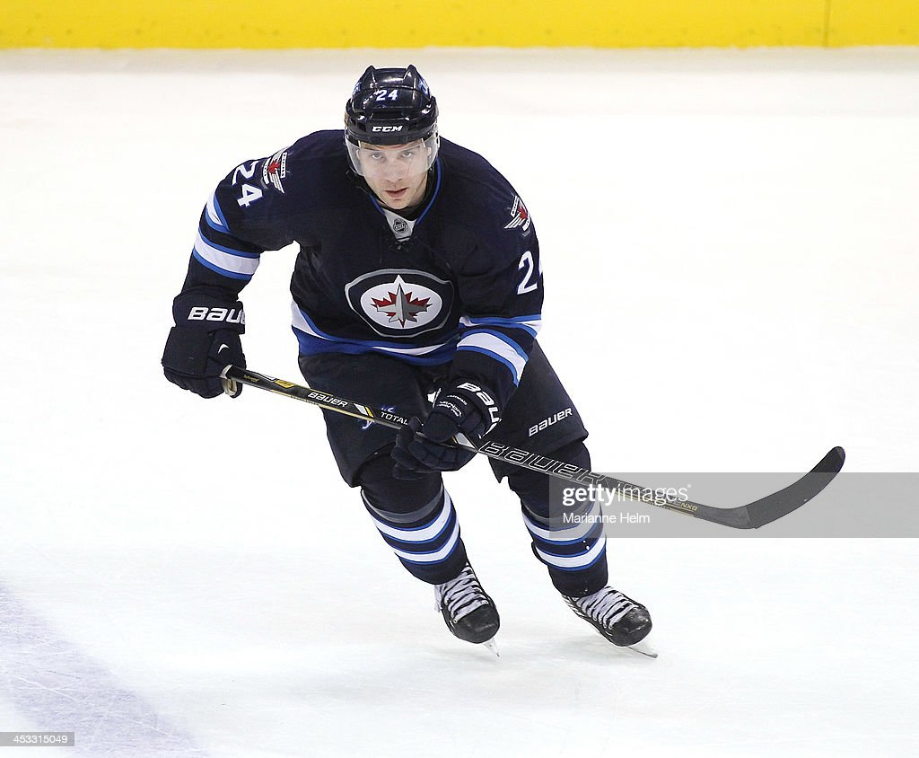 Grant Clitsome of the Winnipeg Jets skates down the ice during third period action in an NHL game against the Calgary Flames at the MTS Centre on...
