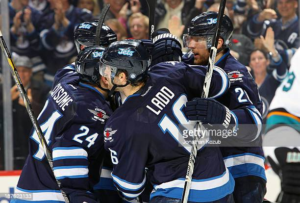Grant Clitsome Zach Bogosian Andrew Ladd and Blake Wheeler of the Winnipeg Jets celebrate a third period game tying goal against the San Jose Sharks...
