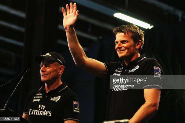 Grant Dalton and Dean Barker of Team New Zealand thank the crowd during their official welcome home function at Shed 10 on October 4 2013 in Auckland...