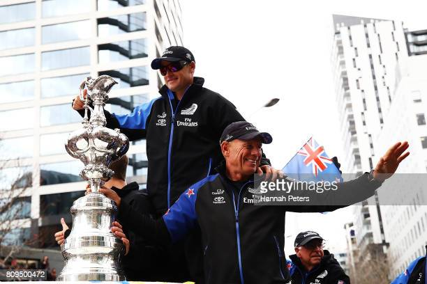 Grant Dalton and Glenn Ashby celebrate with the Americas Cup during the Team New Zealand Americas Cup Welcome Home Parade on July 6 2017 in Auckland...