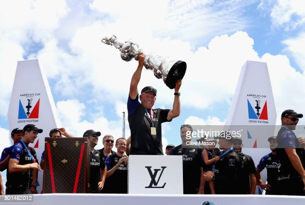 Grant Dalton lifts the cup as Emirates Team New Zealand win race 9 against Oracle Team USA to win the America's Cup on day 5 of the America's Cup...