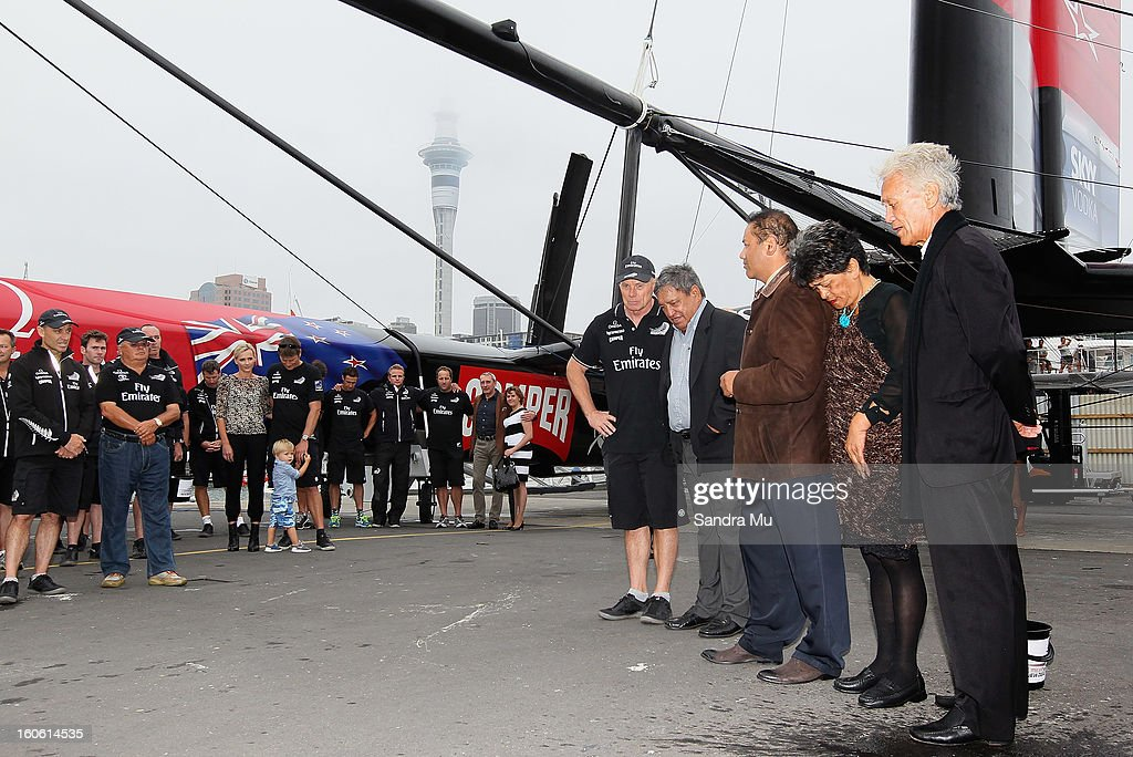 Grant Dalton Managing Director of Team New Zealand (C) is seen doing a karakia during the launch of the Emirates Team New Zealand boat at the Viaduct Harbour on February 4, 2013 in Auckland, New Zealand.