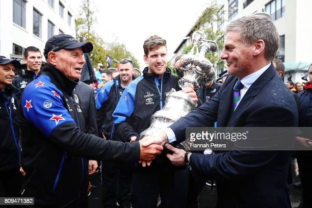 Grant Dalton of Team New Zealand is congratulated by New Zealand Prime Minister Bill English during the Team New Zealand Americas Cup Welcome Home...