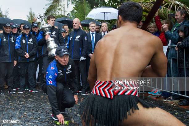 CEO Grant Dalton picks up the dart and accepts a Maori challenge as members of the Emirates Team New Zealand parade the America's Cup yachting trophy...