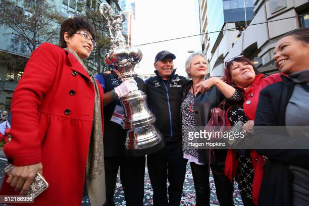 CEO Grant Dalton poses with fans during the Team New Zealand Americas Cup Wellington Welcome Home Parade on July 11 2017 in Wellington New Zealand