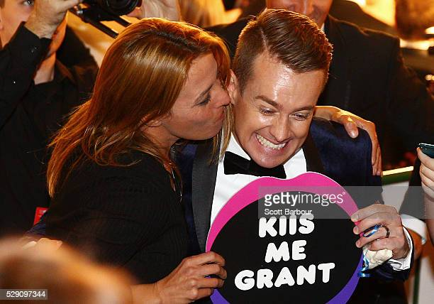 Grant Denyer is kissed by a supporter in the audience as he arrives at the 58th Annual Logie Awards at Crown Palladium on May 8 2016 in Melbourne...