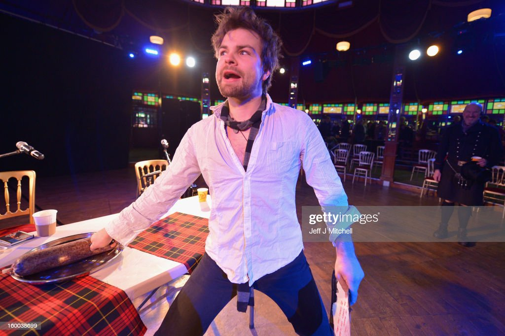 Grant Dinwoodie cuts a haggis in the Spiegel tent during 60 minute Burns Supper being held as part of events taking place to celebrate the birth of poet Robert Burn on January 25, 2012 in Dumfries, Scotland. Burns suppers will be held today to commemorate the life of the poet Robert Burns, who was born on this day in 1759.