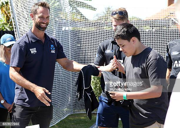 Grant Elliot hads out some gear after cricket fan Christopher BrabantHenry aged 14 and his sister Regan aged 7 from Mangere can't believe their luck...