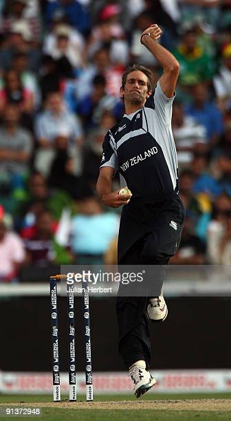 Grant Elliott of New Zealand bowls during The 2nd ICC Champions Trophy Semi Final between New Zealand and Pakistan at Wanderers Stadium on October 3...