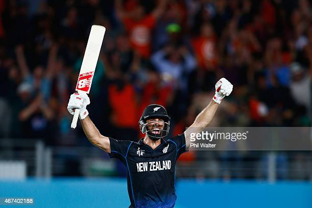 Grant Elliott of New Zealand celebrates hitting the winning runs during the 2015 Cricket World Cup Semi Final match between New Zealand and South...
