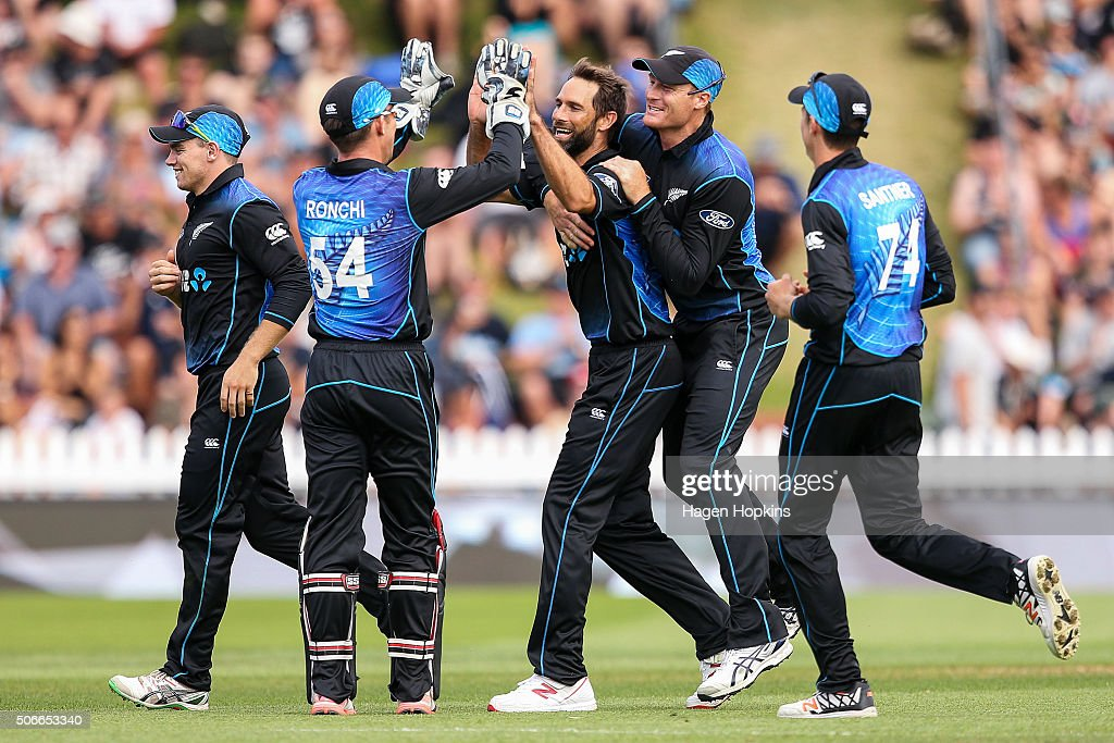 <a gi-track='captionPersonalityLinkClicked' href=/galleries/search?phrase=Grant+Elliott&family=editorial&specificpeople=708027 ng-click='$event.stopPropagation()'>Grant Elliott</a> of New Zealand celebrates with <a gi-track='captionPersonalityLinkClicked' href=/galleries/search?phrase=Luke+Ronchi&family=editorial&specificpeople=724790 ng-click='$event.stopPropagation()'>Luke Ronchi</a> and <a gi-track='captionPersonalityLinkClicked' href=/galleries/search?phrase=Martin+Guptill&family=editorial&specificpeople=797559 ng-click='$event.stopPropagation()'>Martin Guptill</a> after taking the wicket of Sohaib Maqsood of Pakistan during the One Day International match between New Zealand and Pakistan at Basin Reserve on January 25, 2016 in Wellington, New Zealand.