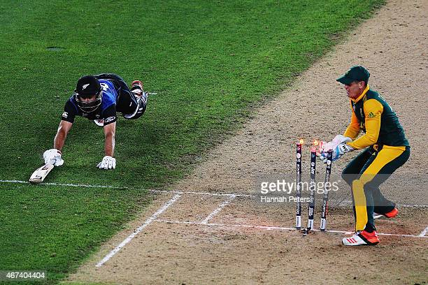 Grant Elliott of New Zealand dives back into his crease during the 2015 Cricket World Cup Semi Final match between New Zealand and South Africa at...