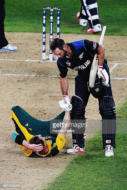 Grant Elliott of New Zealand helps Dale Steyn of South Africa up after winning the 2015 Cricket World Cup Semi Final match between New Zealand and...