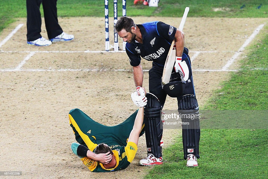 Grant Elliott of New Zealand helps Dale Steyn of South Africa up after winning the 2015 Cricket World Cup Semi Final match between New Zealand and South Africa at Eden Park on March 24, 2015 in Auckland, New Zealand.