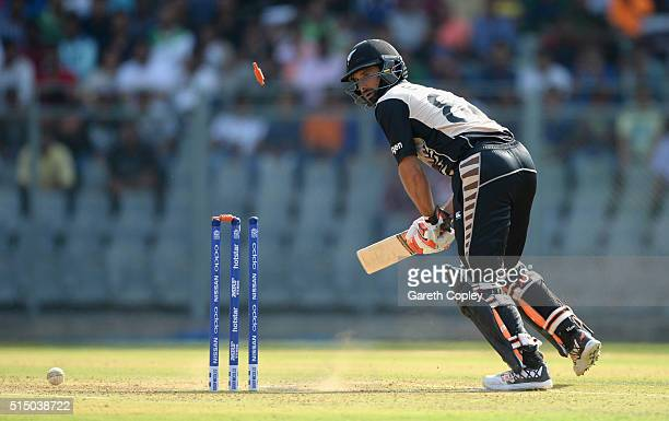 Grant Elliott of New Zealand is bowled by Reece Topley of England during the ICC Twenty20 World Cup warm up match between New Zealand and England at...